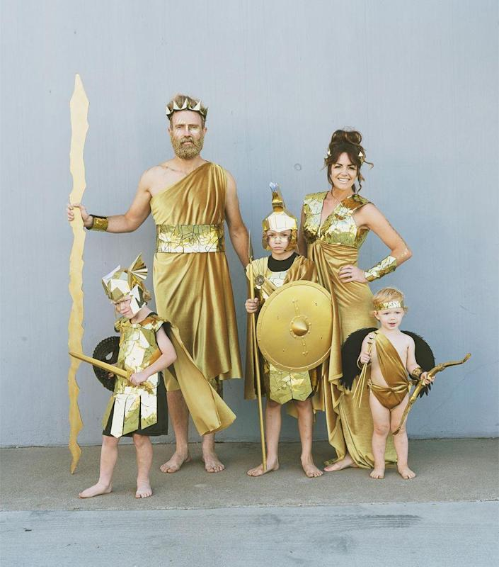 """<p>Does it get any more majestic than being draped in gold? This fun group costume idea will have your crew feeling sky-high. </p><p><strong>Get the tutorial at <a href=""""https://tellloveandparty.com/2019/09/diy-greek-god-family-costume.html"""" rel=""""nofollow noopener"""" target=""""_blank"""" data-ylk=""""slk:Tell Love and Party"""" class=""""link rapid-noclick-resp"""">Tell Love and Party</a>. </strong></p><p><a class=""""link rapid-noclick-resp"""" href=""""https://www.amazon.com/Cricut-2003076-Adhesive-Foil-Gold/dp/B01517SLSY/ref=sr_1_5?dchild=1&keywords=Cricut%C2%AE+Metallic+Adhesive+Foil+gold&qid=1627649652&sr=8-5&tag=syn-yahoo-20&ascsubtag=%5Bartid%7C10050.g.32906192%5Bsrc%7Cyahoo-us"""" rel=""""nofollow noopener"""" target=""""_blank"""" data-ylk=""""slk:Shop Metallic Foil"""">Shop Metallic Foil</a><br></p>"""