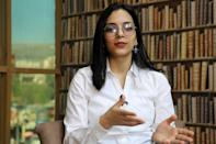 Rawan Salim, an 18-year-old activist, had to flee to northern Kurdistan region after being threatened for taking part in protests