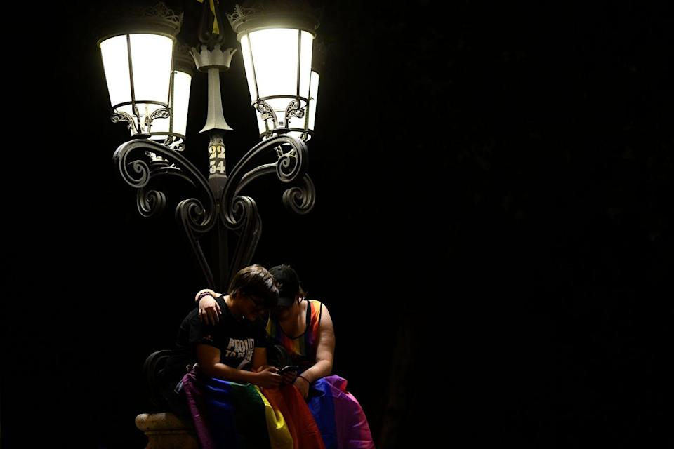 <p>A couple reflects after an annual pride parade in Madrid, Spain. <br></p>