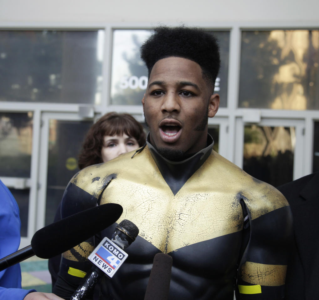 "FILE - In this Oct. 13, 2011 file photo, Benjamin Fodor, a self-styled superhero who goes by the name ""Phoenix Jones,"" talks to reporters after Fodor appeared in court in Seattle. As more people _ often, young people _ fashion themselves into superheroes, they risk finding themselves in similar situations where they wind up hurting innocent members of the public or being shot, stabbed or beaten themselves. (AP Photo/Ted S. Warren, File)"