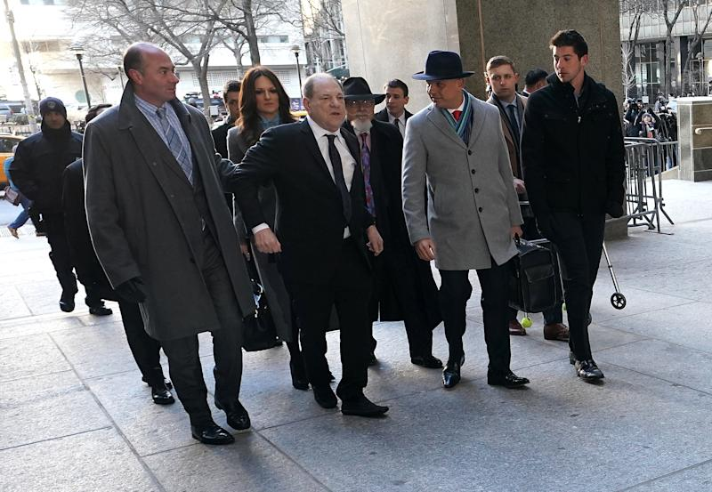 Harvey Weinstein (C) arrives at the Manhattan Criminal Court, on Jan. 22, 2020 for opening arguments in his rape trial in New York City. | AFP via Getty Images