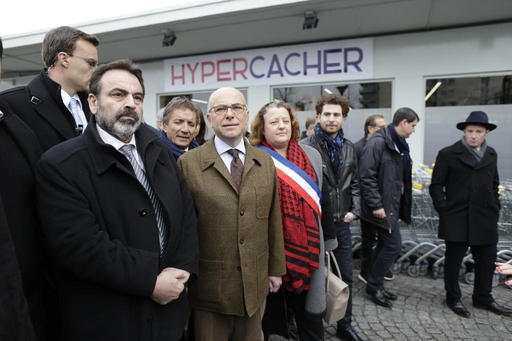 French Interior Minister Bernard Cazeneuve (2nd left) and French Jewish leader Joel Mergui (left) arrive at the Hyper Cacher supermarket in Paris, on March 15, 2015 (AFP Photo/Kenzo Tribouillard)