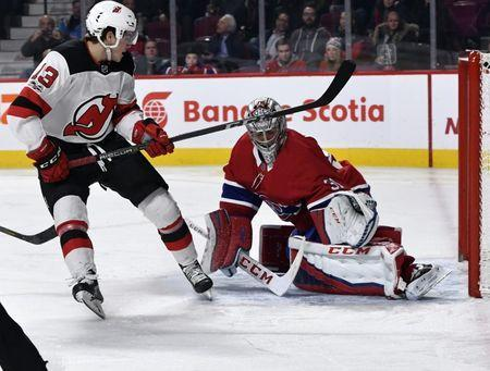 Dec 14, 2017; Montreal, Quebec, CAN; Montreal Canadiens goalie Carey Price (31) stops New Jersey Devils forward Nico Hischier (13) during the third period at the Bell Centre. Mandatory Credit: Eric Bolte-USA TODAY Sports