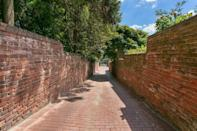 <p>A private driveway and parking area lets residents avoid prying eyes (and having to parallel park).</p>