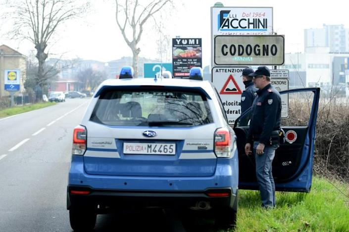 Italian police closed off 11 northern towns in a bid to stem the spread of COVID-19 (AFP Photo/Miguel MEDINA)