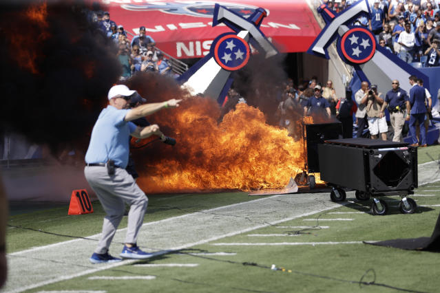 A fire from a pyrotechnics machine burns on the field before an NFL football game between the Tennessee Titans and the Indianapolis Colts. (AP)