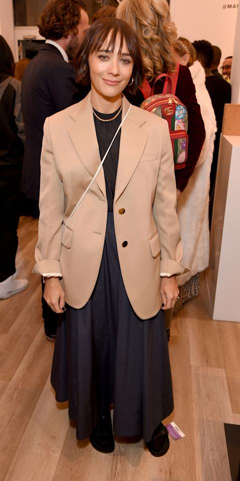 <p>Rashida has officially convinced us to invest in a beige blazer. She layered one over her black shirt and navy skirt, adding a simple gold necklace and gold hoops to complete the look.</p>