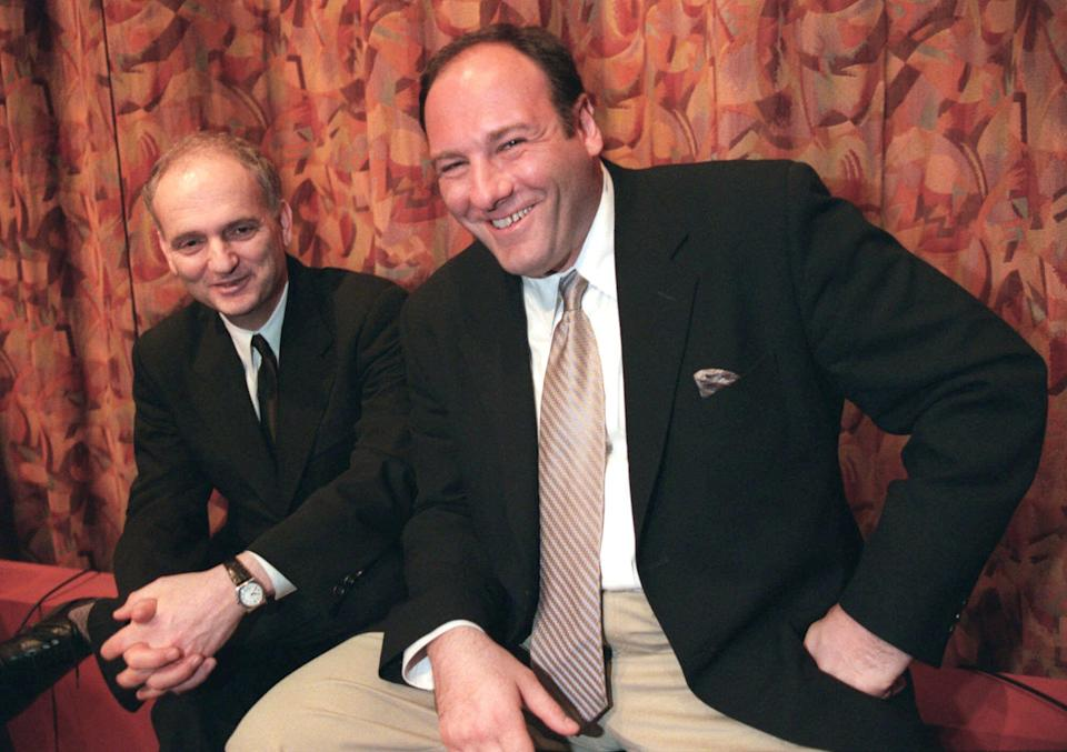 """FILE - In this March 31, 1999 file photo, actor James Gandolfini, right, and David Chase, creator of the HBO television series """"The Sopranos,"""" pose together after a panel discussion at the Writers Guild in Beverly Hills, Calif. Gandolfini, whose portrayal of a brutal, emotionally delicate mob boss in HBO's """"The Sopranos"""" helped create one of TV's greatest drama series and turned the mobster stereotype on its head, died Wednesday, June 19, 2013 in Italy. He was 51. (AP Photo/Jill Connelly)"""