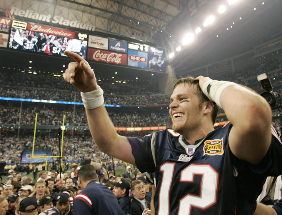 Tom Brady came out of nowhere to win Super Bowl XXXVI with the Patriots to cap the 2001 season, and would go on to win five more titles. (REUTERS/Win McNamee GAC)