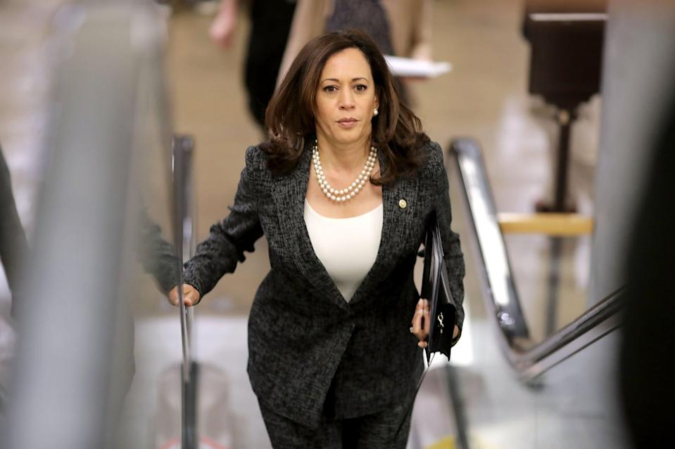 <p>Kamala Harris meant business as Senator at the U.S. Capitol in May 2017, coordinating her pearls with a sleek, fitted tank top underneath her cross-stitch salt-and-pepper pantsuit.</p>