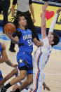 Orlando Magic guard Cole Anthony (50) goes to the basket past Oklahoma City Thunder forward Mike Muscala, right, in the first half of an NBA basketball game Tuesday, Dec. 29, 2020, in Oklahoma City. (AP Photo/Sue Ogrocki)