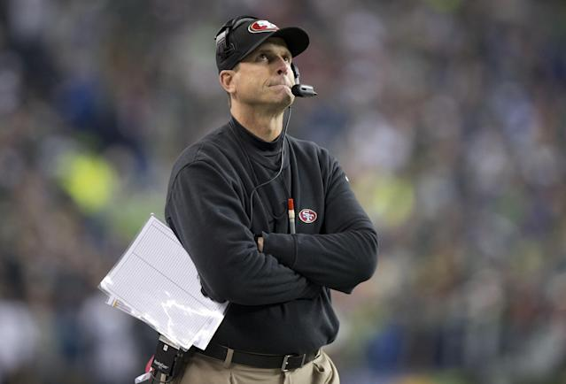 Jim Harbaugh 49ers head coach looks at the scoreboard as the Seahawks go to a 23-17 victory during the NFC championship game between the San Francisco 49ers and the Seattle Seahawks at CenturyLink Field in Seattle, Wash. on Sunday, Jan. 19, 2014. (AP Photo/The Sacramento Bee, Hector Amezcua)