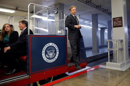 FILE PHOTO: Sen. Rand Paul (R-KY) makes his way to the Capitol ahead of the party luncheons on Capitol Hill in Washington, U.S., September 19, 2017. REUTERS/Aaron P. Bernstein