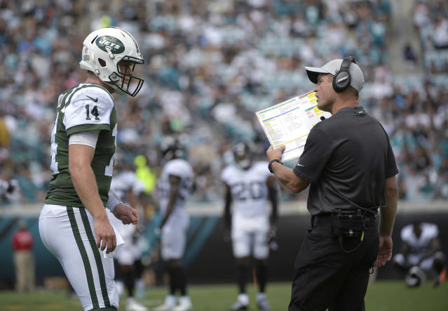 "FILE - In this Sept. 30, 2018, file photo, New York Jets quarterback Sam Darnold (14) talks with offensive coordinator Jeremy Bates during the first half of the team's NFL football game against the Jacksonville Jaguars on in Jacksonville, Fla. Bates knows what the Jets are doing on offense just isn't cutting it. The offensive coordinator has heard all about it, taking his fair share of criticism from fans and media the past several weeks. ""This profession is about grinding,"" Bates said Thursday, Dec. 6. ""You've got to move to the next week. You can't look at last week and lose sleep on it. You've got to turn the page."" (AP Photo/Phelan M. Ebenhack, File)"