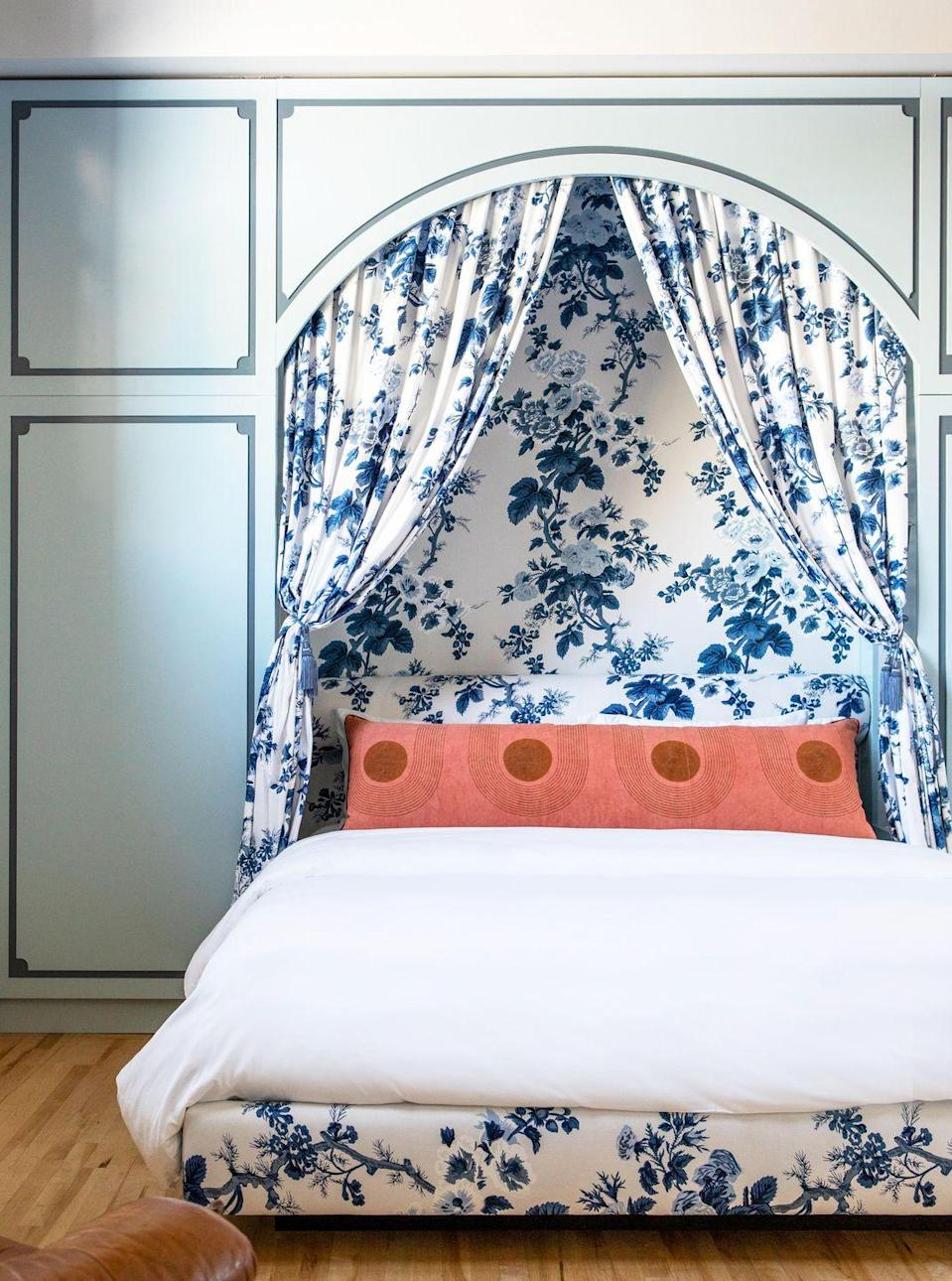 "<p>A <a href=""https://www.housebeautiful.com/room-decorating/bedrooms/g717/headboard-designs/"" rel=""nofollow noopener"" target=""_blank"" data-ylk=""slk:headboard"" class=""link rapid-noclick-resp"">headboard</a> is cool, but this is your main bedroom, after all, so go all out and add a footboard, canopy, and statement wall, too. A bold pattern and color make any room pop. Take note of this edgy yet classic space by <a href=""https://www.etcforshort.com/"" rel=""nofollow noopener"" target=""_blank"" data-ylk=""slk:ETC.etera"" class=""link rapid-noclick-resp"">ETC.etera</a> and mix toile fabric with something geometric and mod. </p>"