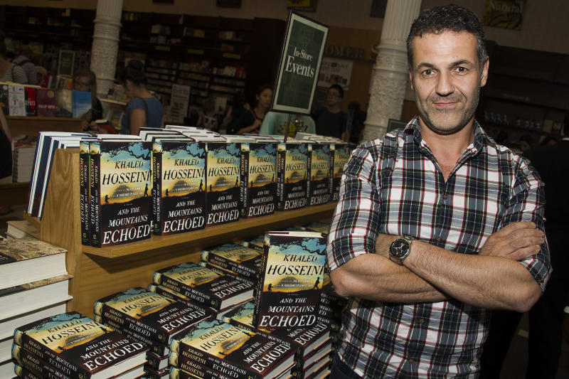 "Author Khaled Hosseini, author of ""And the Mountains Echoed,"" poses for a photo before a book signing event at Barnes & Noble on Tuesday, May 21, 2013 in New York. (Photo by Charles Sykes/Invision/AP)"