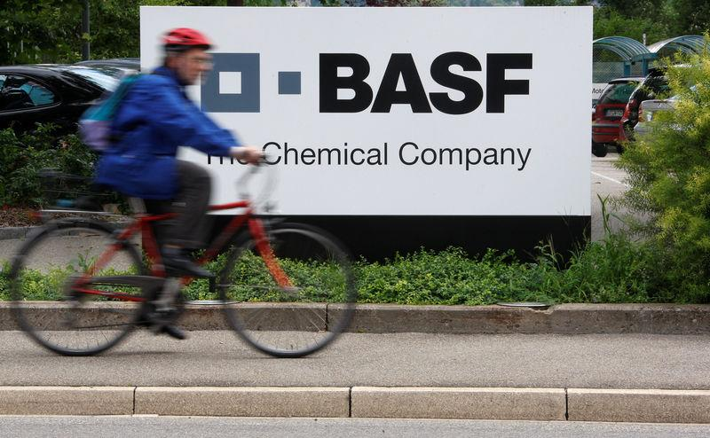 c1e8217f1fd3 FILE PHOTO  A cyclist rides his bike bast the entrance of the BASF plant in
