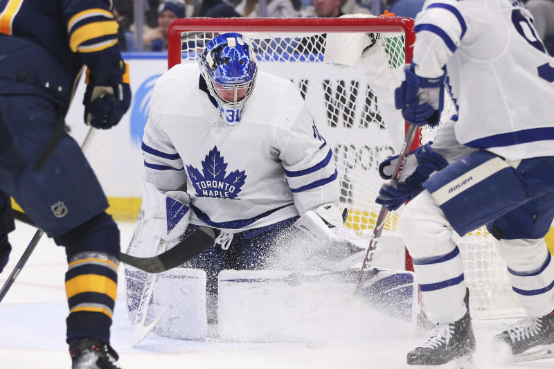 Toronto Maple Leafs goalie Frederik Andersen (31) makes a pad save during the third period of the team's NHL hockey game against the Buffalo Sabres, Sunday, Feb. 16, 2020, in Buffalo, N.Y. (AP Photo/Jeffrey T. Barnes)