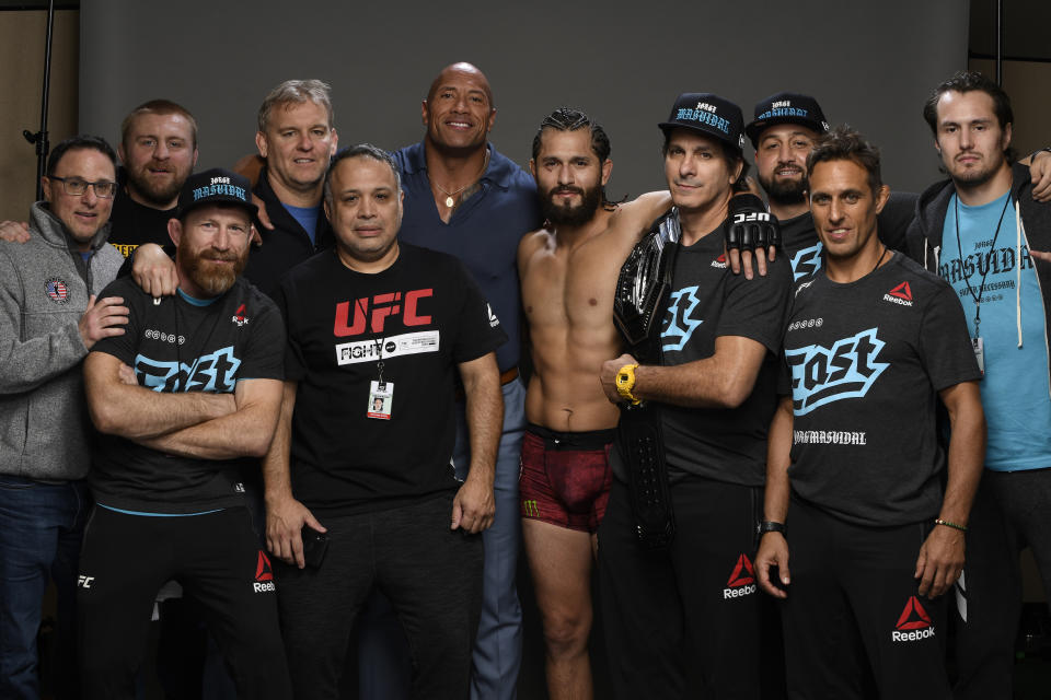 Former featherweight world champion turned coach Mike Brown (third from the left) has established himself as one of the best teachers in all of MMA (Getty Images).