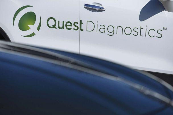 PHOTO: Quest Diagnostics Inc. signage is displayed on a vehicle parked at a drive-through coronavirus testing facility at Bergen Community College in Paramus, N.J., March 21, 2020. (Angus Mordant/Bloomberg via Getty Images, FILE)