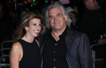 """Director Paul Greengrass and Joanna Greengrass arrive for the European premiere of """"Captain Phillips"""", on the opening night of the London Film Festival, at the Odeon Leicester Square in central London October 9, 2013. REUTERS/Suzanne Plunkett"""