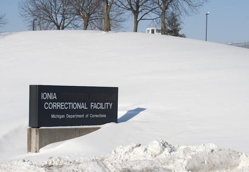 Snow blankets the Ionia Correctional Facility in Michigan Monday Feb. 3, 2014. A national manhunt is underway for convicted murderer Michael Elliot who escaped Sunday from the prison. (AP Photo/The Grand Rapids Press, Chris Clark) ALL LOCAL TV OUT; LOCAL TV INTERNET OUT