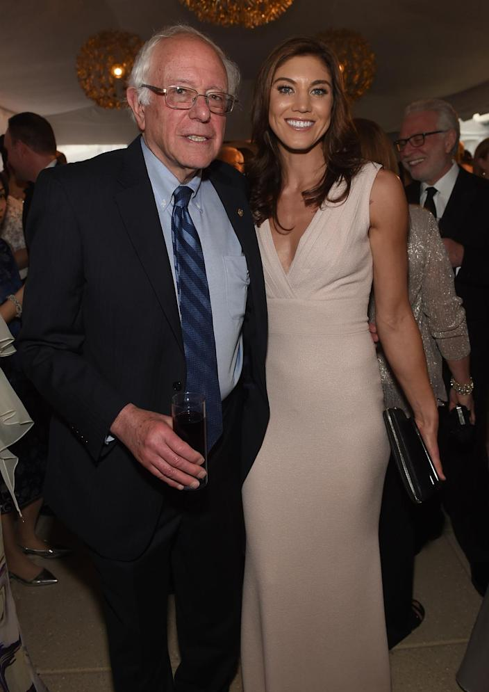 <p>Sen. Bernie Sanders and soccer player Hope Solo attend Atlantic Media's 2016 White House Correspondents' Association pre-dinner reception at the Washington Hilton, April 30. <i>(Photo: Jamie McCarthy/Getty Images)</i></p>