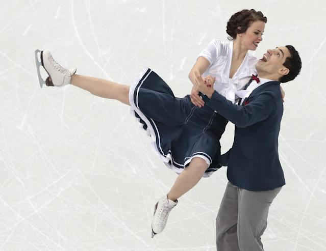 Anna Cappellini and Luca Lanotte of Italy compete in the ice dance short dance figure skating competition at the Iceberg Skating Palace during the 2014 Winter Olympics, Sunday, Feb. 16, 2014, in Sochi, Russia. (AP Photo/Ivan Sekretarev)