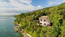 """<p>Part of Small Luxury Hotels of the World,<a href=""""https://www.bluefieldsvillas.com/"""" rel=""""nofollow noopener"""" target=""""_blank"""" data-ylk=""""slk:Bluefields Bay Villas"""" class=""""link rapid-noclick-resp""""> Bluefields Bay Villas</a> is the perfect place to enjoy a boutique experience with the amenities and peace of mind of an all-inclusive resort. Nestled in Jamaica's exotic countryside, this is not your average all-inclusive Caribbean vacation, thanks to white-glove service, professional nannies, personal chefs, senior care, and countless other unique offerings.</p><p>The resort features just six villas, which hold two, three, four, or six bedrooms for all kinds of family gatherings. Bluefields Bay offers tailored experiences for everyone in your tribe to cater to each person, from adventurous diving tours to rejuvenating spa treatments. </p>"""