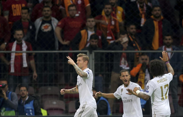 Real Madrid's Toni Kroos, left, celebrates with teammates after scoring his side's opening goal during the Champions League group A soccer match between Galatasaray and Real Madrid in Istanbul, Tuesday, Oct. 22, 2019. (AP Photo)