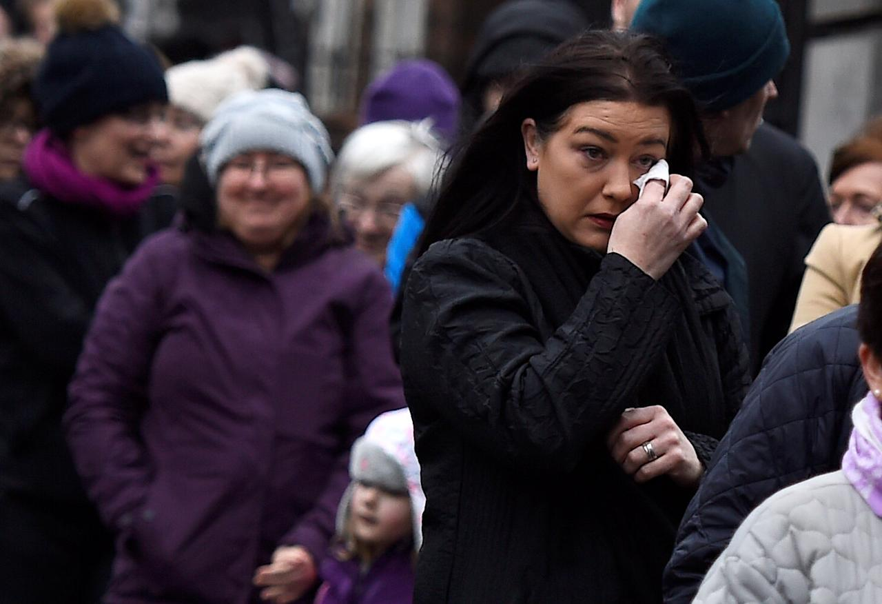 People queue to pay their respects to Dolores O'Riordan, singer with the Cranberries, outside St. Joseph's Church during a public reposal in Limerick, Ireland January 21, 2017. REUTERS/Clodagh Kilcoyne