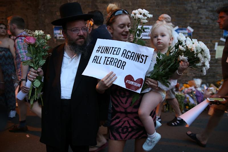 People gather to attend a vigil outside Finsbury Park Mosque, close to the scene of a van attack in Finsbury Park, north London on June 19, 2017