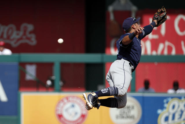 San Diego Padres third baseman Christian Villanueva jumps for a ball hit for a single by Washington Nationals' Matt Adams during the second inning of a baseball game at Nationals Park, Wednesday, May 23, 2018, in Washington. (AP Photo/Alex Brandon)