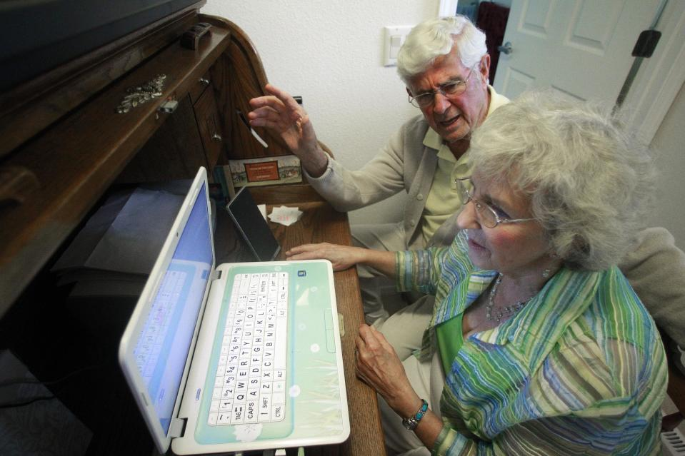 Bruce and Esther Huffman sit a their computer Thursday, Sept. 15, 2011, in McMinnville, Ore. The elderly McMinnville couple has gained unexpected fame after their accidental webcam video reached viral status on YouTube. The three-minute clip of Bruce and Esther Huffman's attempt to snap a photograph on their new laptop computer had reached more than 285,000 viewers by Wednesday evening. (AP Photo/Rick Bowmer)