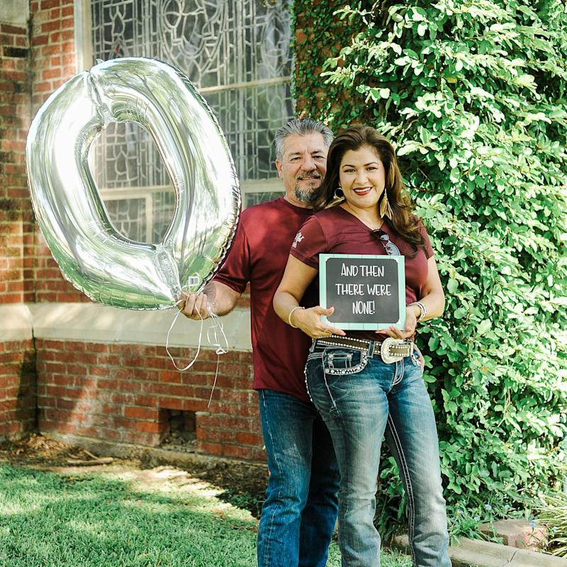 "Juan holds up a zero balloon and Dalila holds up a chalkboard sign that reads: ""And then there were none."" (Photo: <a href=""https://www.instagram.com/photographymelyssaanne/"" target=""_blank"">Melyssa Anne Photography </a>)"