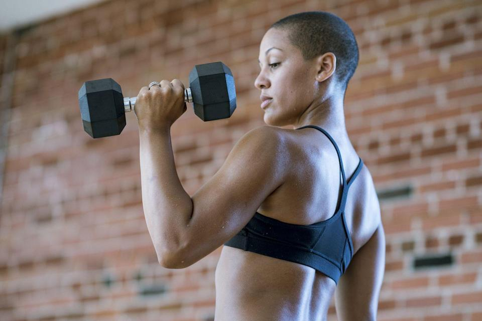 """<p><strong>Dannah Bollig, a certified personal trainer, former division one athlete and the creator of <strong><a href=""""https://www.dannaheve.com/"""" rel=""""nofollow noopener"""" target=""""_blank"""" data-ylk=""""slk:The DE Method"""" class=""""link rapid-noclick-resp"""">The DE Method </a></strong></strong>loves this move that is a fantastic bicep and tricep workout for females.</p><p><strong><strong>How to:</strong></strong> Stand tall with feet hip-width apart and hold a dumbbell in each hand with your palms facing each other. Perform a curl with the dumbbell and then press overhead, ensuring that the palms face towards each other for the entire time. </p>"""