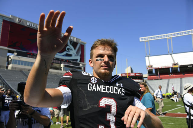 South Carolina quarterback Ryan Hilinski threw two TDs in his first start. (AP Photo/John Amis)