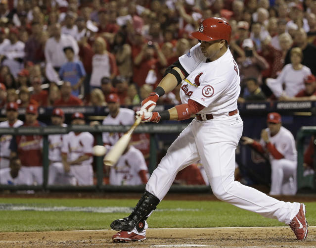 St. Louis Cardinals' Carlos Beltran hits a two-run scoring double during the third inning of Game 1 of the National League baseball championship series against the Los Angeles Dodgers Friday, Oct. 11, 2013, in St. Louis. (AP Photo/David J. Phillip)