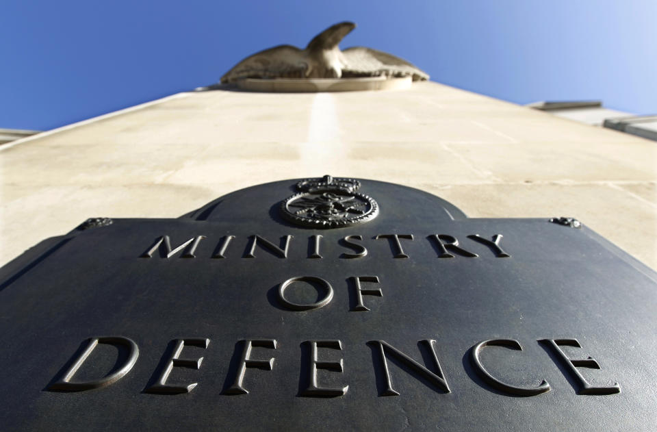 A plaque is seen on the Ministry of Defence building entrance in London, September 15, 2010. British legislators warned the government on Wednesday that the country's military capabilities and its ability to conduct current operations could be endangered if it goes ahead with deep defence cuts. REUTERS/Suzanne Plunkett (BRITAIN - Tags: POLITICS MILITARY)