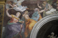 "A detail of the 1514 fresco ""Sybils receiving instruction from Angels"" by Italian High Renaissance master painter Raffaello Sanzio, known as Raphael, adorns the inside of Santa Maria della Pace church, in Rome, Monday, Dec. 14, 2020. Like elsewhere in Europe, museums and art galleries in Italy were closed this fall to contain the spread of COVID-19, meaning art lovers must rely on virtual tours to catch a glimpse of the treasures held by famous institutions such as the Uffizi in Florence and the Vatican Museums in Rome. However, some exquisite gems of Italy's cultural heritage remain on display in real life inside the country's churches, some of which have collections of renaissance art and iconography that would be the envy of any museum. (AP Photo/Andrew Medichini)"