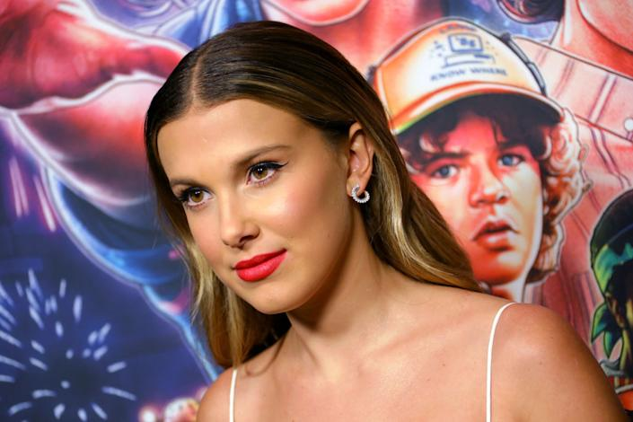 Millie Bobby Brown has addressed some of the difficulties she's faced growing up in the spotlight. Pictured here in November 2019 (Getty)