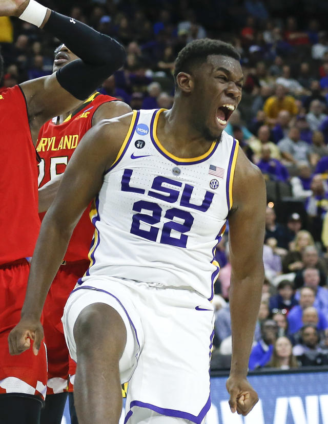 <p>LSU's Darius Days (22) celebrates after sinking a shot against Maryland during the first half of a second-round game in the NCAA men's college basketball tournament in Jacksonville, Fla., Saturday, March 23, 2019. (AP Photo/Stephen B. Morton) </p>