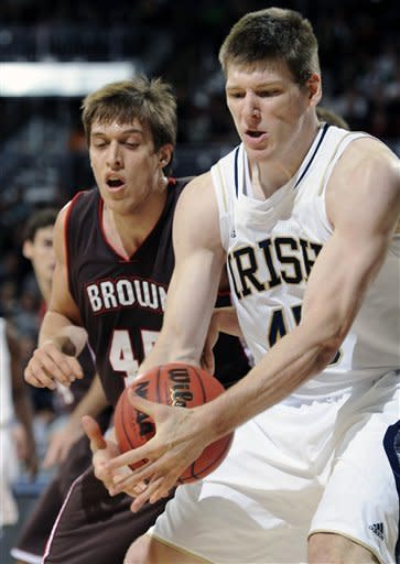 Notre Dame forward Jack Cooley, right, grabs a rebound in front of Brown forward Rafael Maia gives chase in the first half of an NCAA college basketball game with Brown on Saturday, Dec. 8, 2012 in South Bend, Ind. (AP Photo/Joe Raymond)