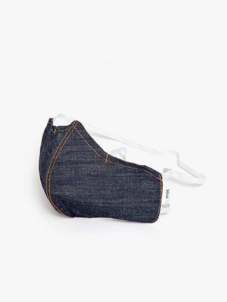 """<p><strong>Mother</strong></p><p>motherdenim.com</p><p><strong>$24.00</strong></p><p><a href=""""https://go.redirectingat.com?id=74968X1596630&url=https%3A%2F%2Fwww.motherdenim.com%2Fproducts%2Fthe-adjustable-dont-spray-it-sld-solid&sref=https%3A%2F%2Fwww.harpersbazaar.com%2Ffashion%2Ftrends%2Fg32192171%2Ffashion-brands-masks-coronavirus%2F"""" rel=""""nofollow noopener"""" target=""""_blank"""" data-ylk=""""slk:Shop Now"""" class=""""link rapid-noclick-resp"""">Shop Now</a></p><p>The go-to denim house is taking its specialty to masks. </p>"""