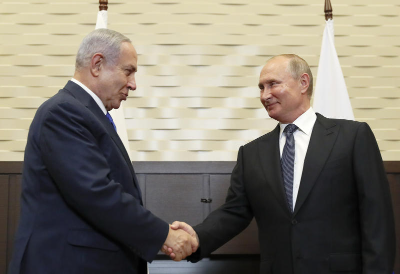 FILE - In this Sept. 12, 2019 file photo, Russian President Vladimir Putin, right, shakes hands with Israeli Prime Minister Benjamin Netanyahu during their meeting in Sochi, Russia.   Netanyahu, locked in a razor tight race and facing the likelihood of criminal corruption charges, a decisive victory in Tuesday, Sept. 17, vote may be the only thing to keep him out of the courtroom.(Shamil Zhumatov/Pool Photo via AP, File)