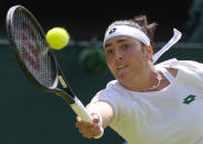 Tunisia's Ons Jabeur plays a return to Spain's Garbine Muguruza during the women's singles third round match on day five of the Wimbledon Tennis Championships in London, Friday July 2, 2021. (AP Photo/Kirsty Wigglesworth)