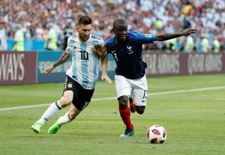 Soccer Football - World Cup - Round of 16 - France vs Argentina - Kazan Arena, Kazan, Russia - June 30, 2018 France's N'Golo Kante in action with Argentina's Lionel Messi REUTERS/John Sibley