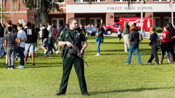 PHOTO: A Marion County Sheriff's Deputy stands outside Forest High School as students exit the school after a school shooting occurred on April 20, 2018 in Ocala, Fla. (Doug Engle /Star-Banner via AP)