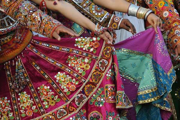 Indian folk dancers from the Panghat Group of Performing Arts participate in a full dress rehearsal for the forthcoming Navratri festivities or Dance Festival of Nine Nights in Ahmedabad on October 7, 2012. Navratri festival begins from October 16 to 24. AFP PHOTO / Sam PANTHAKY