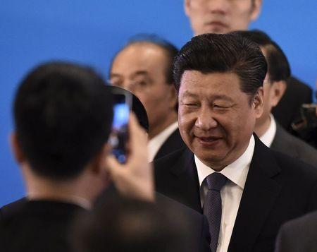 China's President Xi Jinping is photographed by a smartphone at the opening ceremony of the fifth regular foreign ministers' meeting of the Conference on Interaction and Confidence Building Measures in Asia (CICA) at the Diaoyutai State Guesthouse in Beijing Apr28, 2016. REUTERS/KYODO NEWS/IORI SAGISAWA/POOL
